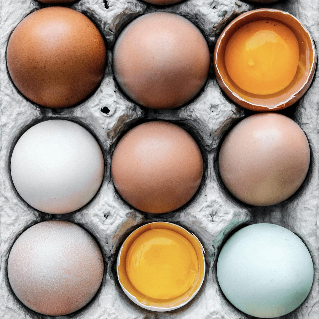 colorful pasture-raised eggs in a carton