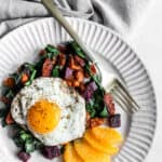 breakfast sweet potatoes on a plate with a fried egg on top